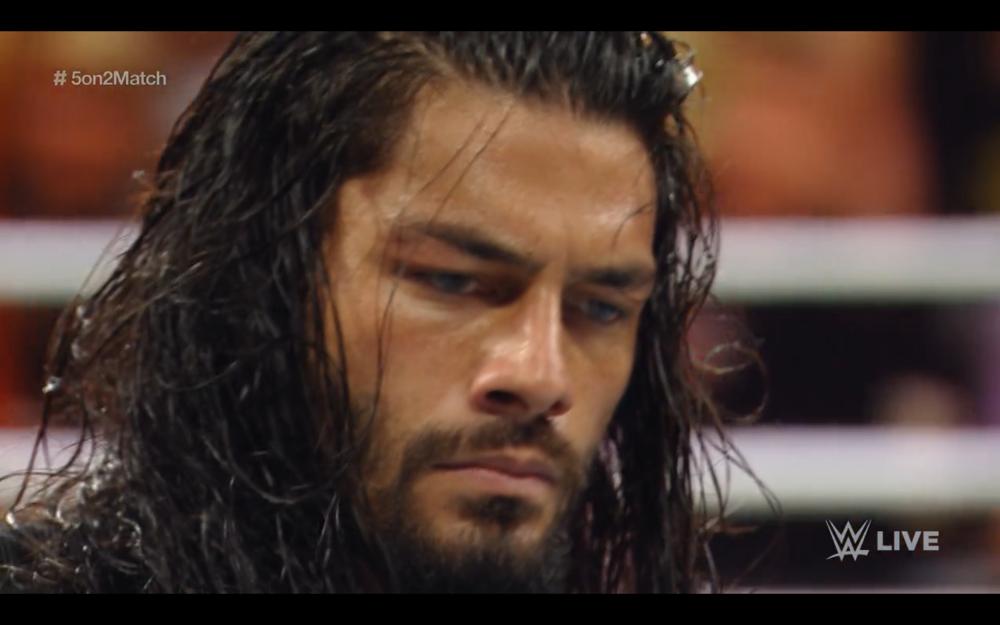 Roman Reigns, having speared Daniel Bryan.