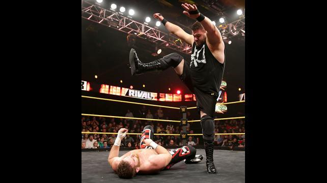 Kevin Owens kicking Sami Zayn.