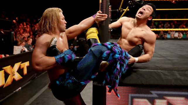 Tyler Breeze (left) vs Hideo Itami (right).