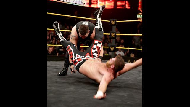 Kevin Owens powerbombs Sami Zayn.