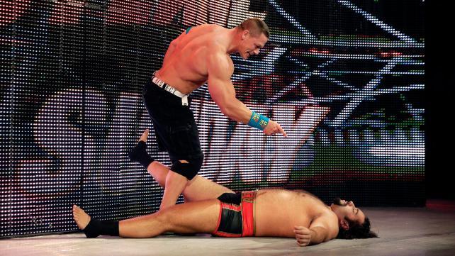 Cena stands triumphant over Rusev.