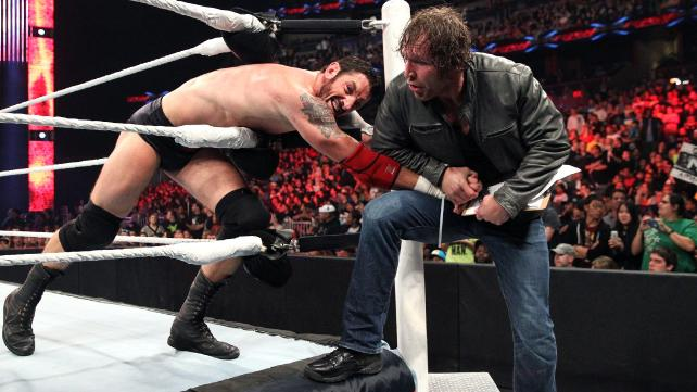 Dean Ambrose forces Wade Barrett to sign a contract for an IC Championship match at Fastlane.