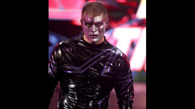 Stardust glares at his fallen brother, Goldust.