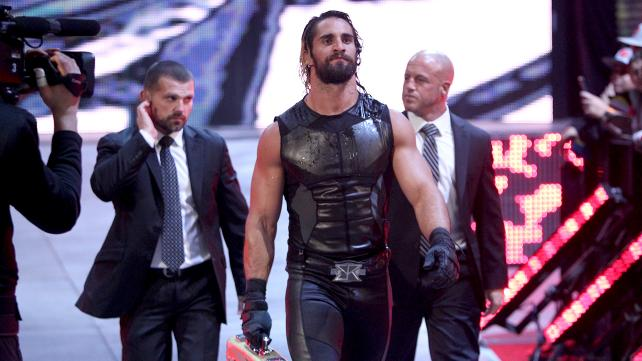 Seth Rollins makes his way to the ring accompanied by J&J Security.