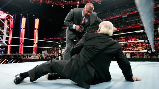 Triple H shoves and screams at Ric Flair.