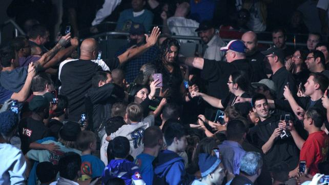 Roman Reigns makes his way through the crowd.