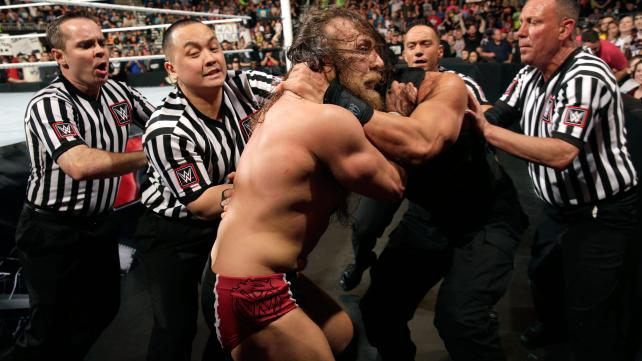 Daniel Bryan and Roman Reigns destroy one another.