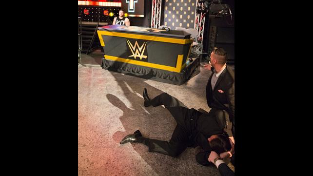 Kevin Owens throws Alex Riley over the announcer's table at the end of the show.