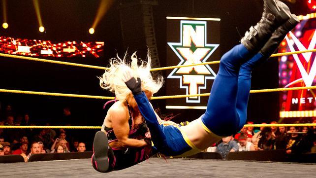 Dana Brooke delivers her finish move - it looks like avariation on The Attitude Adjustment.