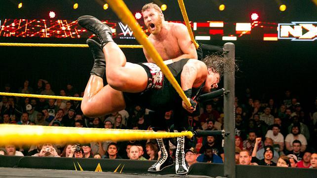 Rhyno rams his shoulder into Sami's ribs.
