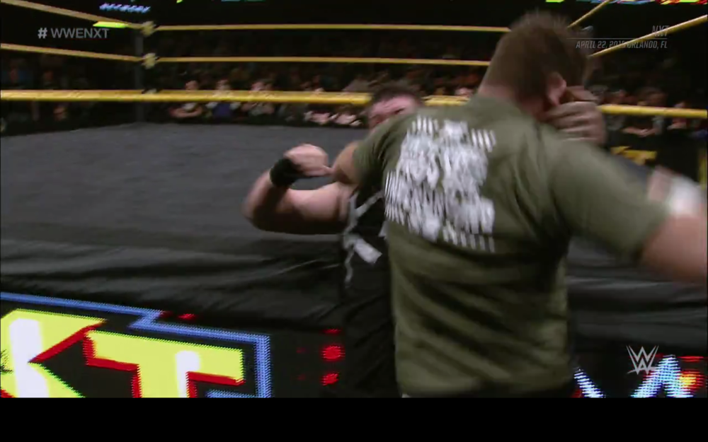 Sami Zayn attacking Kevin Owens. Pardon the motion-blur! It was impossible to get a good screen-cap of this awesomeness.