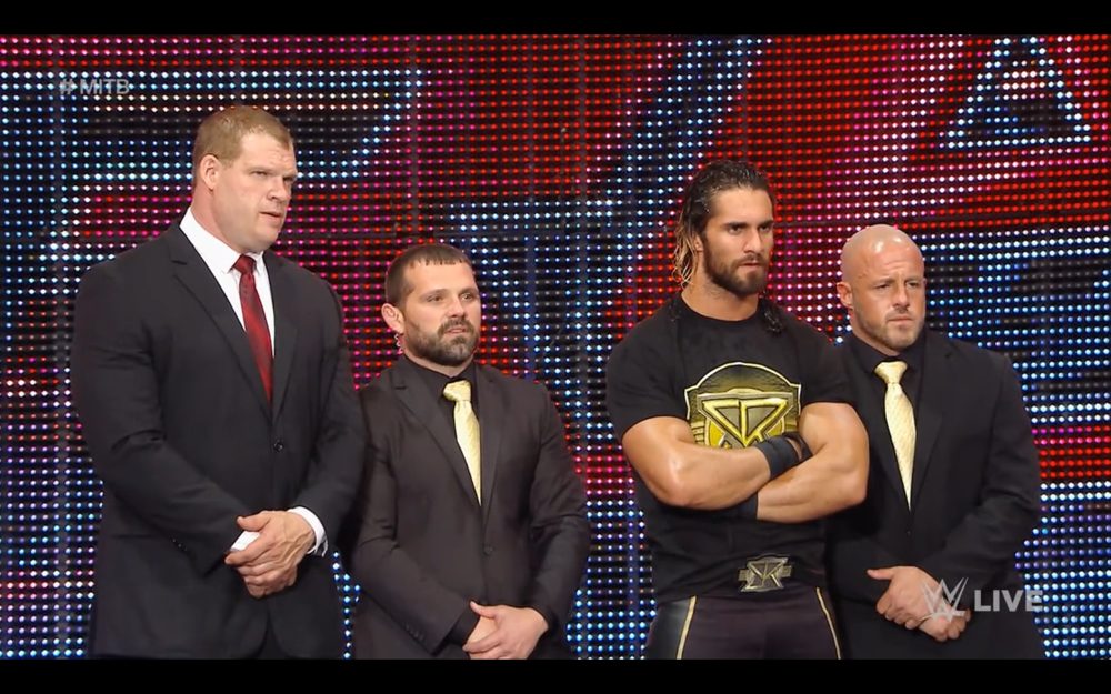 Seth Rollins with J&J Security and Kane.