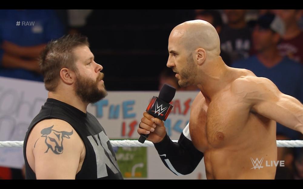 Cesaro confronts Kevin Owens.