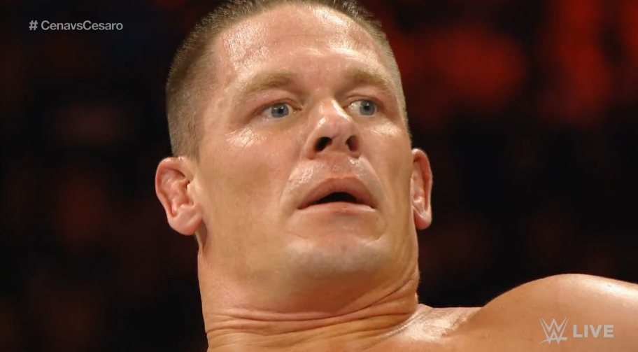 John Cena, exhausted and shocked after Cesaro kicked out of a three count.