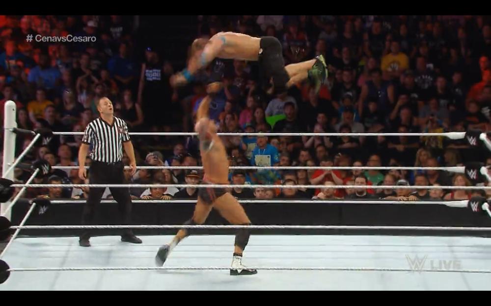 Cesaro pushes Cena into the air for a Super European Uppercut.