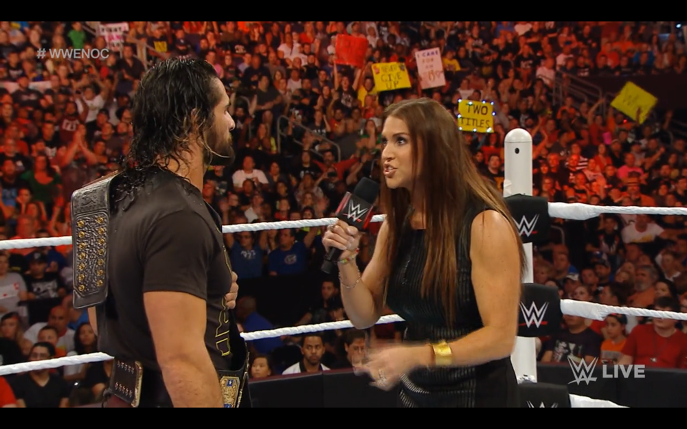 "Stephanie McMahon, serving as ""mom"" to Seth Rollins, chastises and then motivates Seth."