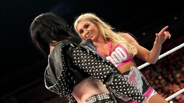 Paige interrupts Charlotte's celebration.