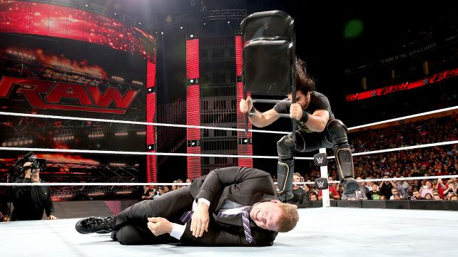 Seth Rollins randomly attacks Kane with a chair.