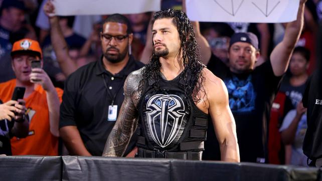 Roman Reigns enters through the crowd.