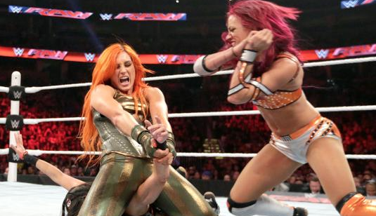 Sasha Banks breaks up Becky's submission hold.