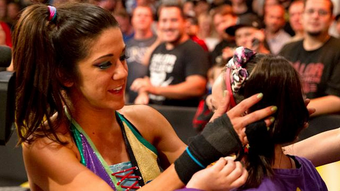 BAYLEY WITH HER SUPER-FAN IZZY.