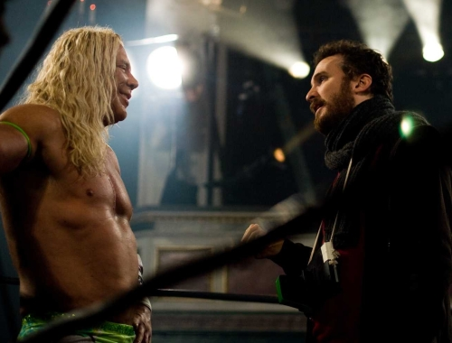 DIRECTOR DARREN ARONOFSKY (RIGHT) DISCUSSES A SCENE WITH MICKEY ROURKE IN THE WRESTLER.