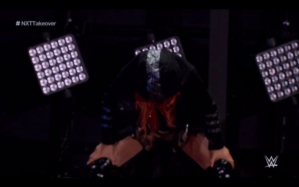 BECKY LYNCH EMERGING FROM BEHIND THE CURTAIN