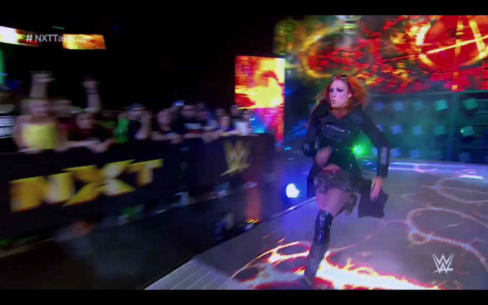 BECKY LYNCH RACES DO THE RING THROUGH A VEIL OF SMOKE LIKE A STEAM PUNK SUPER HERO