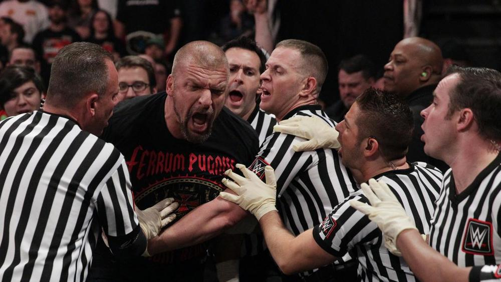 TRIPLE H SCREAMS AT A DEFEATED ROMAN REIGNS