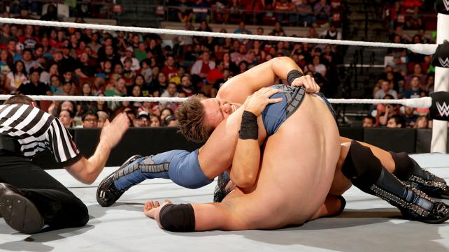 The Miz pulling Damien Mizdow's tights in an effort to gain an unfair advantage during a pin attempt.