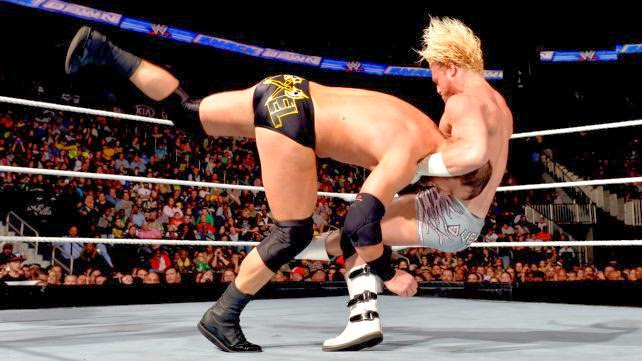 Dolph Ziggler delivers a DDT to Curtis Axel.