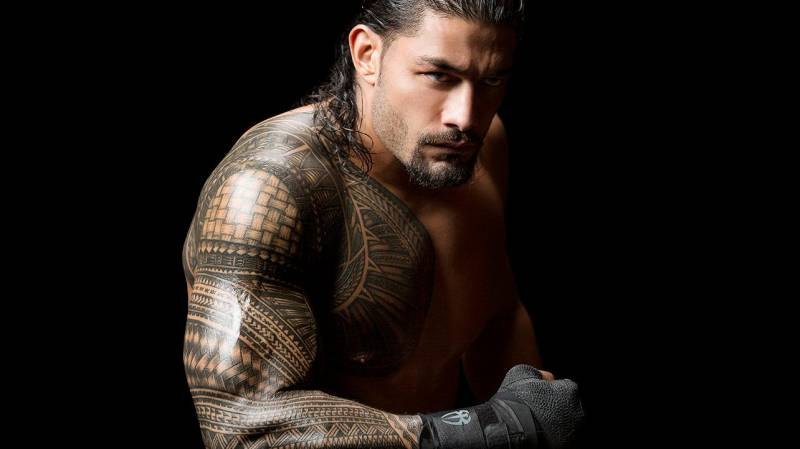 ROMAN REIGNS SHOWS OFF HIS TATTOOS VIA  www.sportskeeda.com