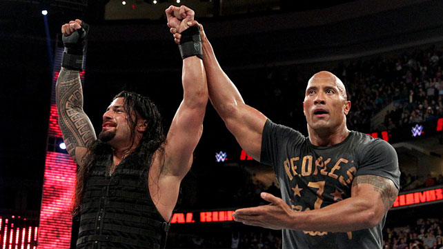 DWAYNE JOHNSON RAISES THE ARM OF ROMAN REIGHNS AT THE 2015 ROYAL RUMBLE