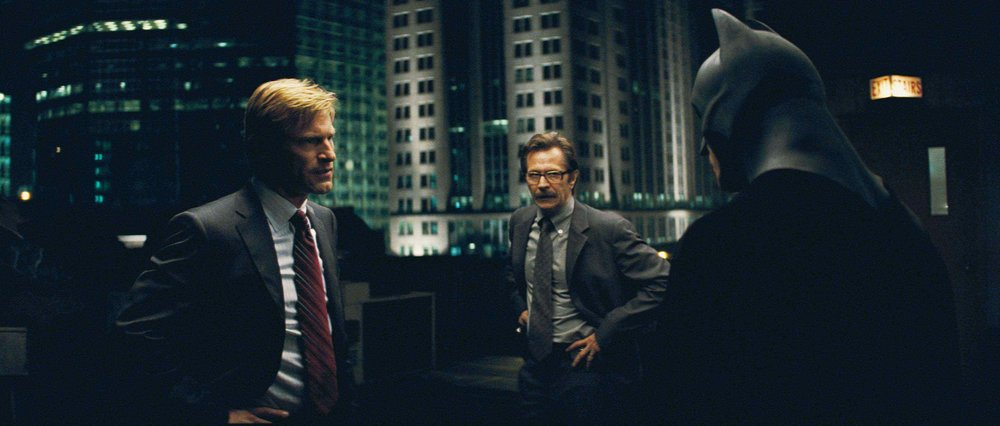 Aaron Eckhart (left), Gary Oldman (center), Christian Bale (right)