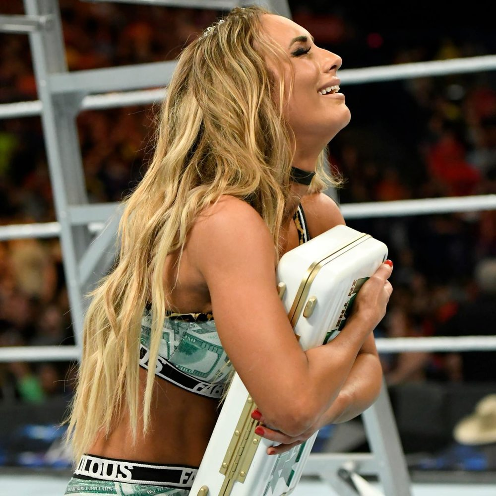 Carmella, after being declared the winner of the first women's MITB