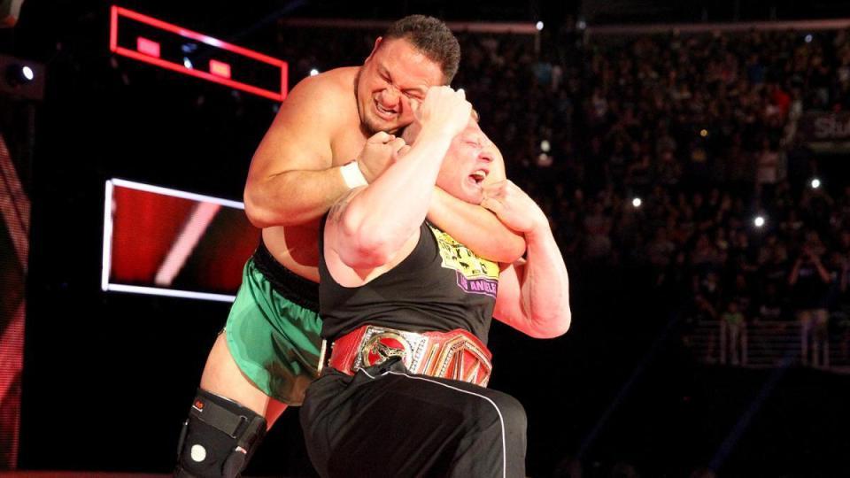 Samoa Joe (left), Brock Lesnar (right)