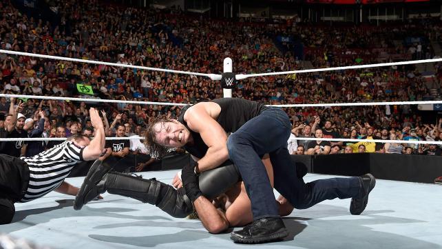 Dean Ambrose rolls up Seth Rollins
