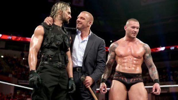 Seth Rollins (right), Triple H (center), Randy Orton (right)