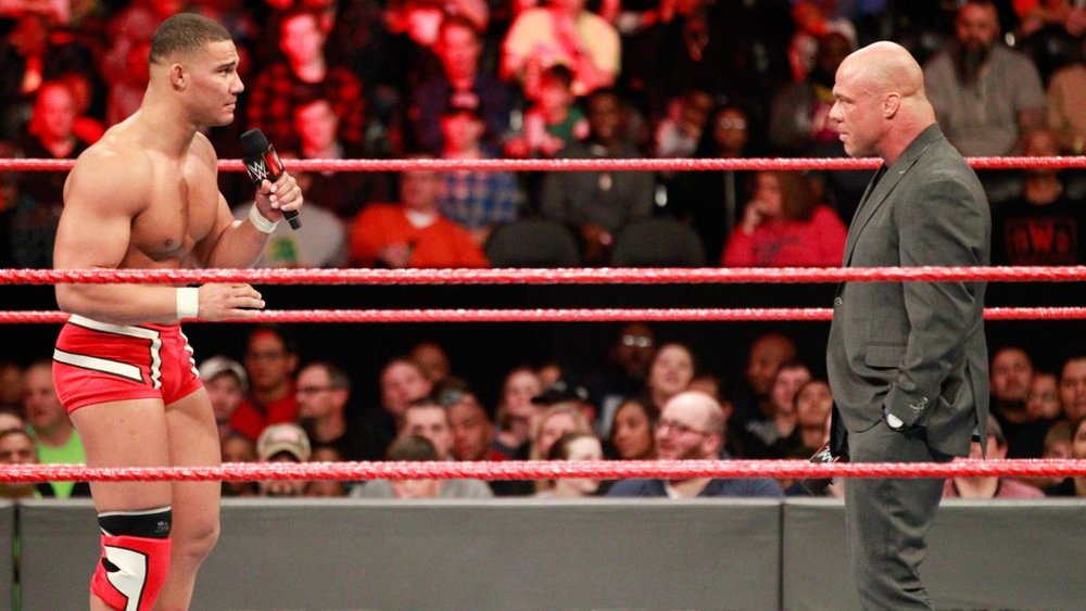 Jason Jordon (left) pleads with Kurt Angle (right) to let him remain in the Survivor Series match despite injury.