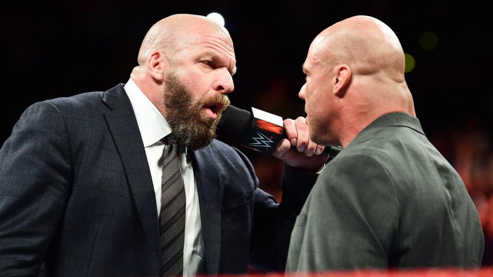 Triple H confronts Kurt Angle.