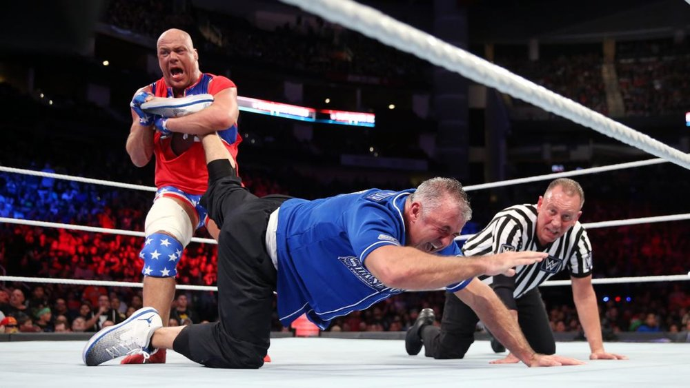 Kurt Angle with Shane McMahon in the ankle lock.