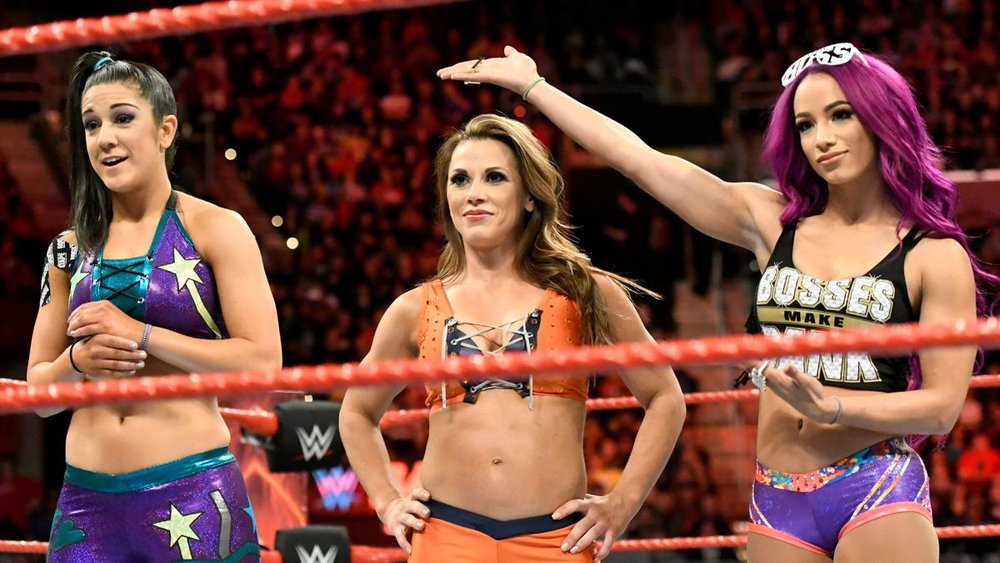 Bailey (left), Mickie James (center), Sasha Banks (right)