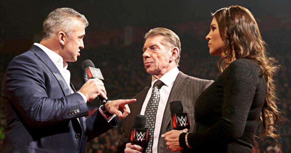 Shane McMahon (left), Vince McMahon (center), Stephanie McMahon (right)