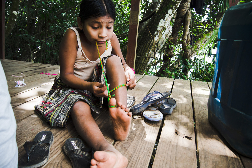 Casa-Guatemala_Girl-Playing-with-String-on-Toes.jpg
