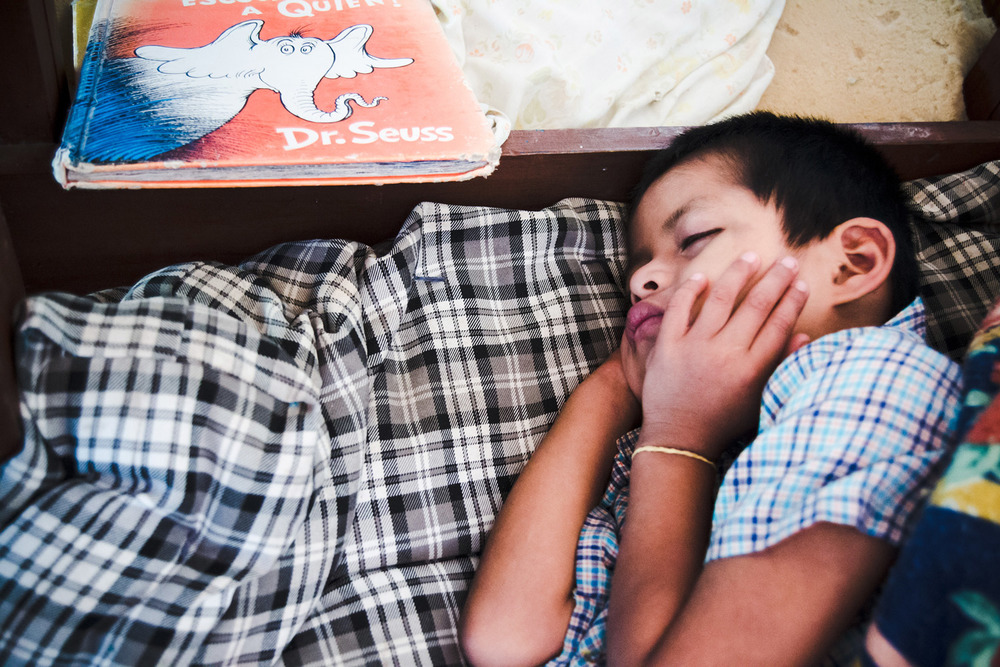 Casa-Guatemala_Boy-Sleeping-with-Book.jpg