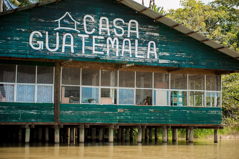 Casa-Guatemala_Waving-Kids-from-Building-on-Water.jpg