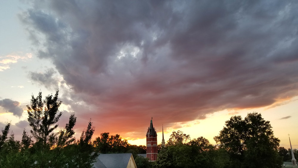 The sun sets on a summer night behind Salisbury's bell tower.