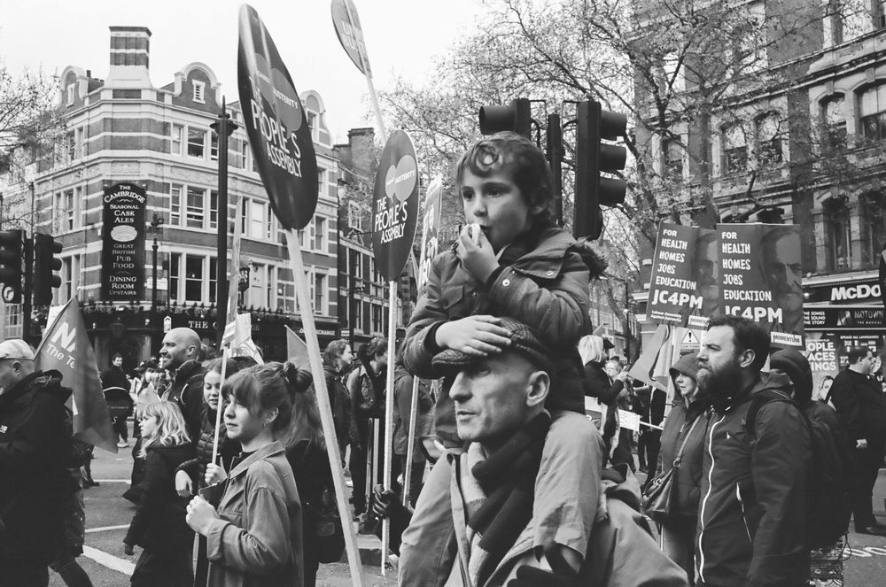 A young demonstrator joins the procession - Clifford Darby 2016