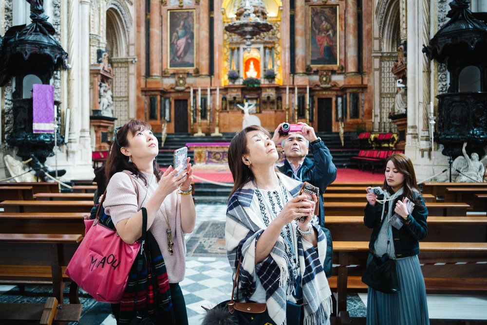 Japanese tourists admire the Mezquita de Córdoba, Córdoba. Spain. 2017.