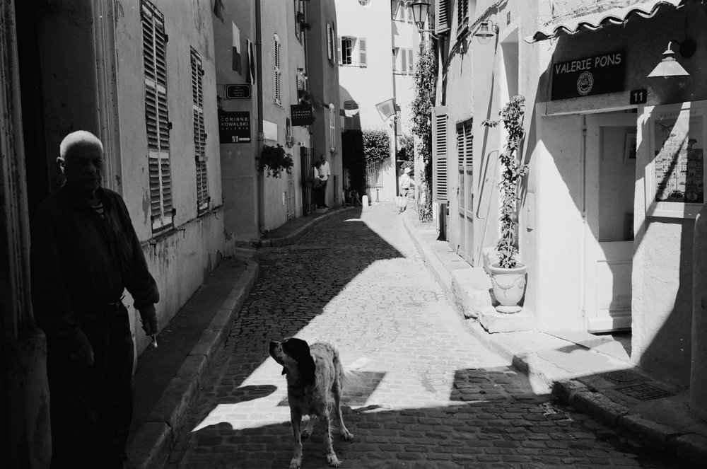 A strange figure and its dog, St. Tropez. France. 2016.